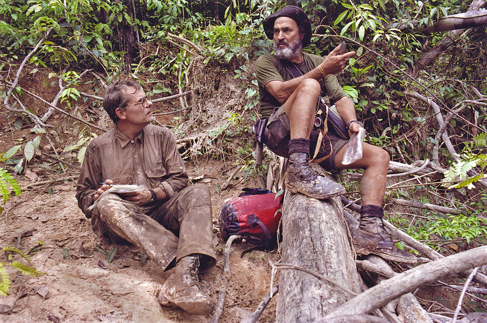 Scott Wallace interviewing explorer and indigenous-rights activist Sydney Possuelo while on assignment for National Geographic in the depths of the Brazilian rainforest, 2002.