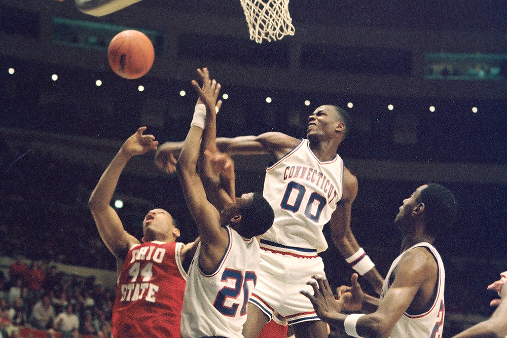 American basketball player Cliff Robinson, of the University of Connecticut, blocks a shot during a game against Ohio State, Hartford Connecticut, 1988