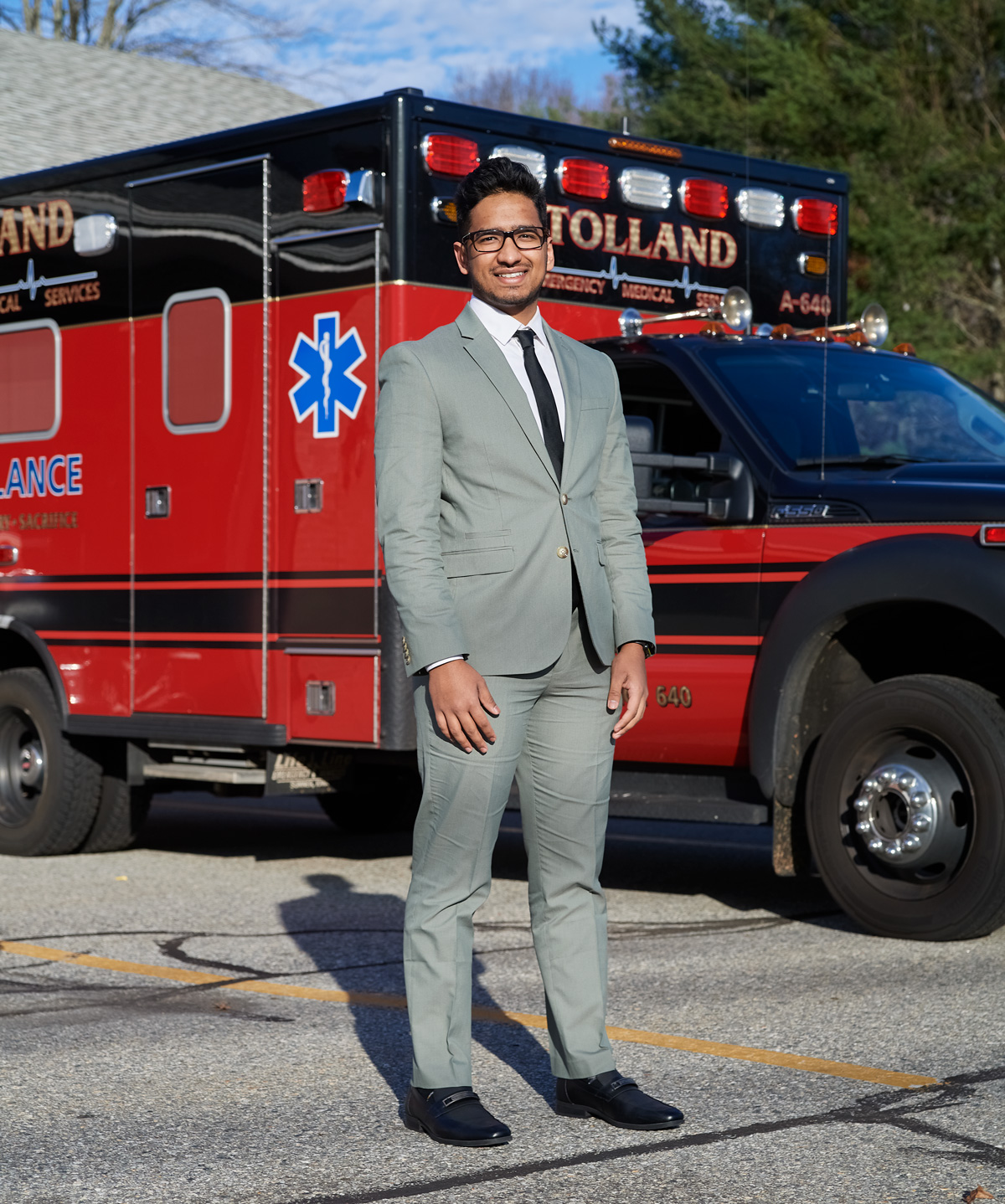 Patel in front of an ambulance