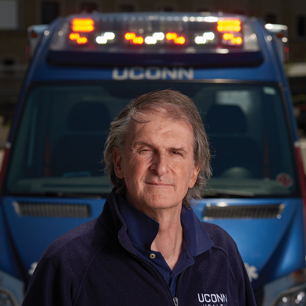 Peter canning in front of an ambulence