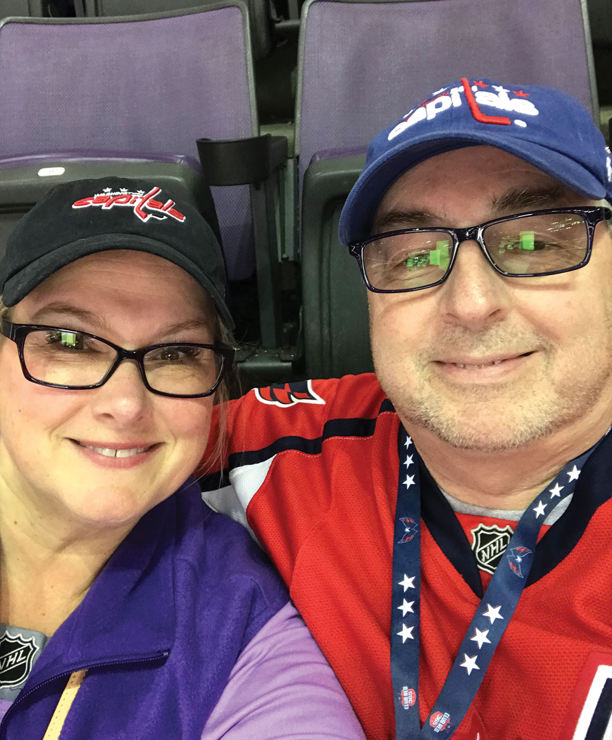 LaFlamme and with his wife, entrepreneur Carolyn Thompson, at a Stanley Cup playoff game — the two are longtime Washington Capitals fans.