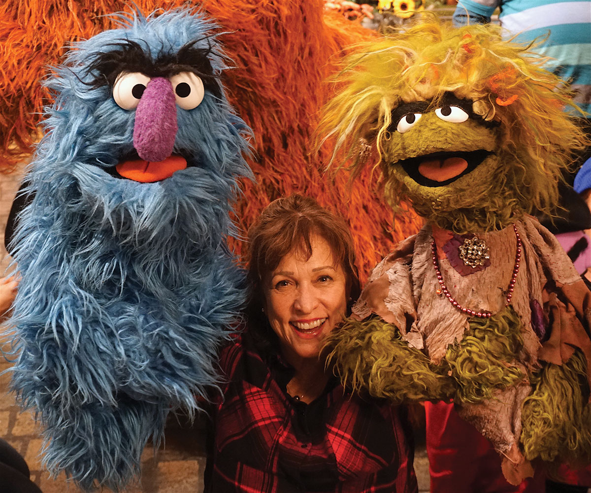 Pam Arcie, puppeteer, with Sesame Street puppets