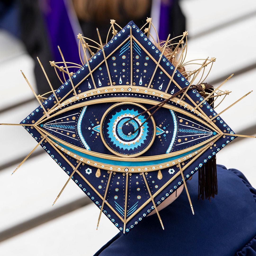 decorative grad cap with intricate blue eye
