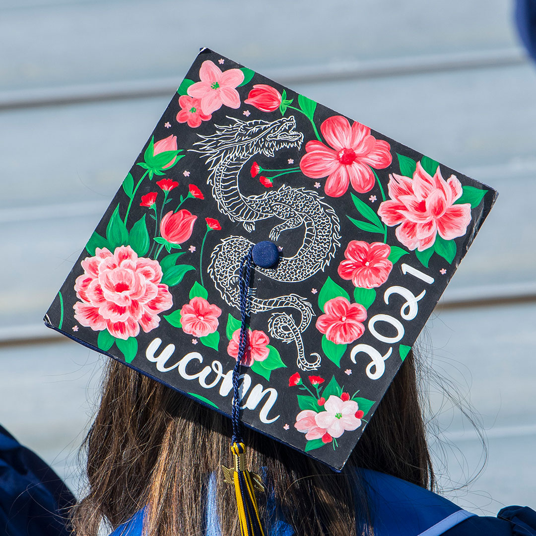 decorative grad cap with a dragon and flowers