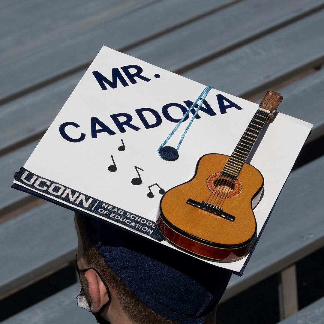 decorative grad cap with a Mr. Cardona and music notes and guiatar