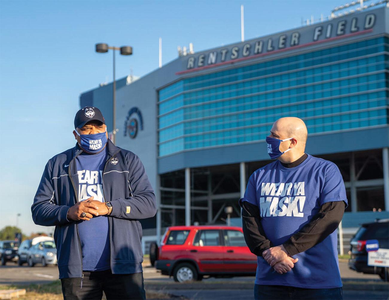 Chris Smith and Jason Jakubowski at Rentschler wearing Wear Ya Mask shirts and masks