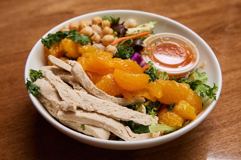 orange chopped salad with vegan faux chicken