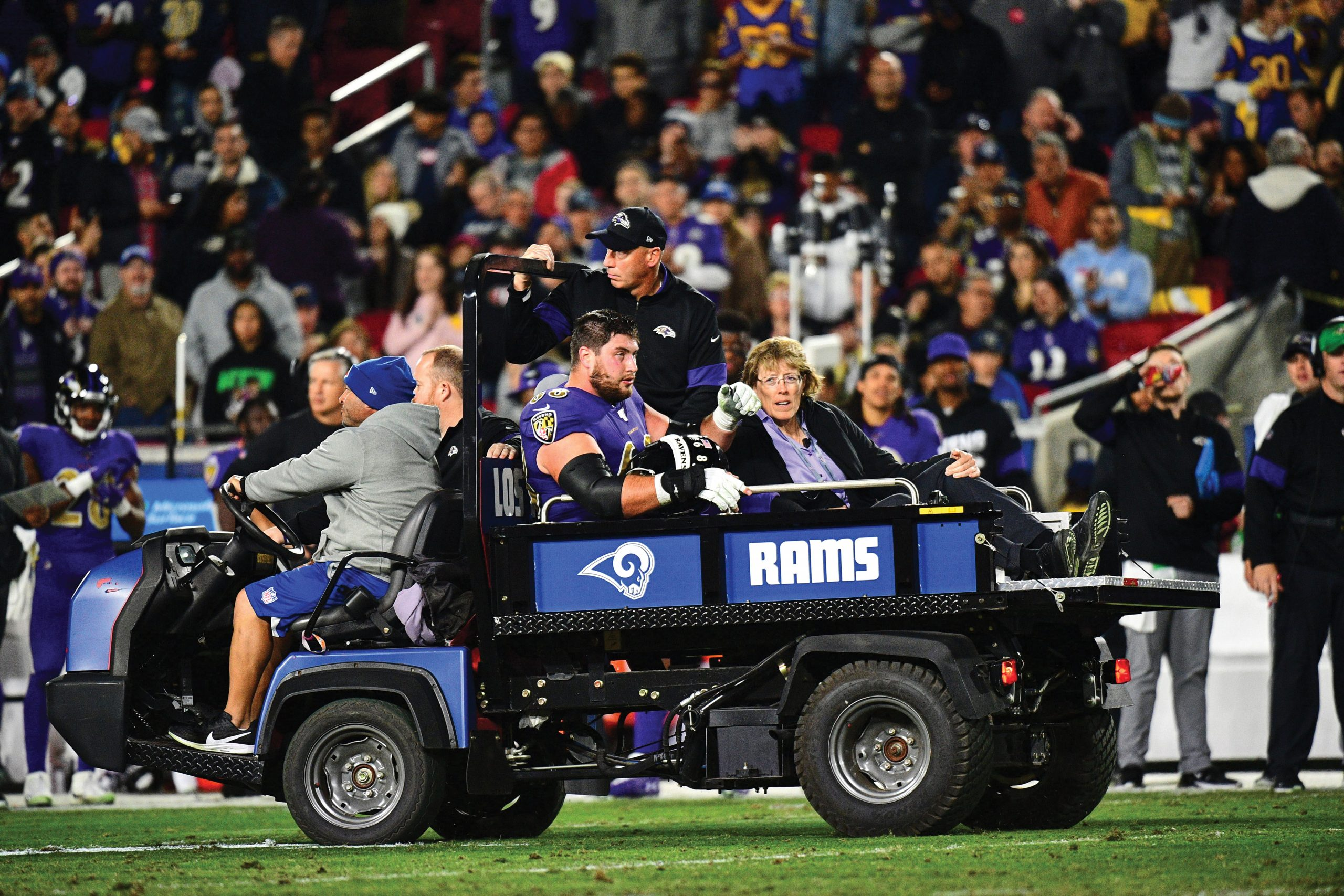 Baltimore Ravens Matt Skura (68) being carted off field with injury during game vs Los Angeles Rams at Los Angeles Memorial Coliseum.
