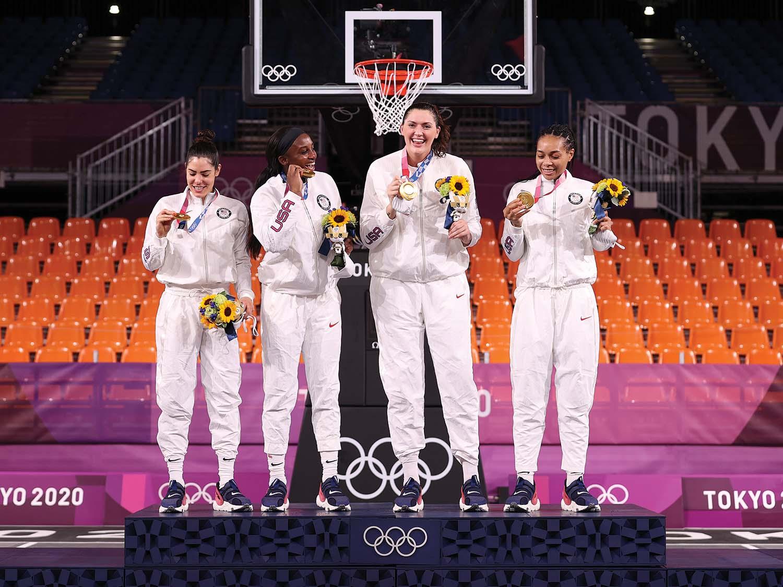 Stefanie Dolson stands on podium with other USA women's 3x3 team