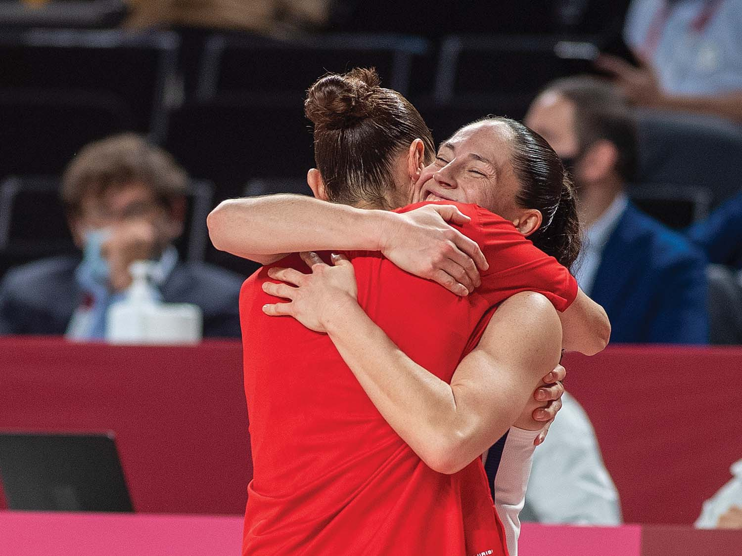 Five-time Olympic gold medalists Diana Taurasi and Sue Bird of the United States celebrate on the sideline after the team victory watched by team mates Brittney Griner #15 of the United States and Jewell Loyd #4 of the United States during the Japan V USA basketball final for women at the Saitama Super Arena during the Tokyo 2020 Summer Olympic Games on August 8, 2021 in Tokyo, Japan.