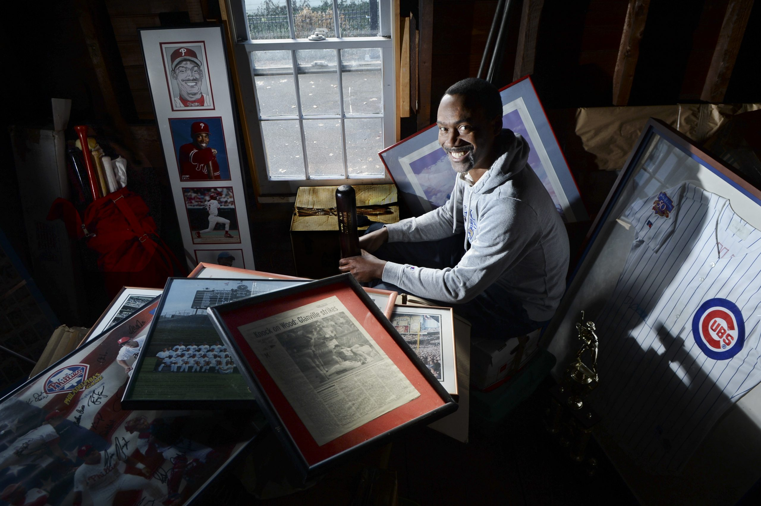 Doug Glanville, the former MLB star who played for nine years in the big leagues, with the Phillies, Cubs and Texans, has an eclectic collection of personal baseball memorabilia stored in the attic over the garage at his west end home. Among the collection in the dusty attic are signed bats, framed articles and portraits of the star player.