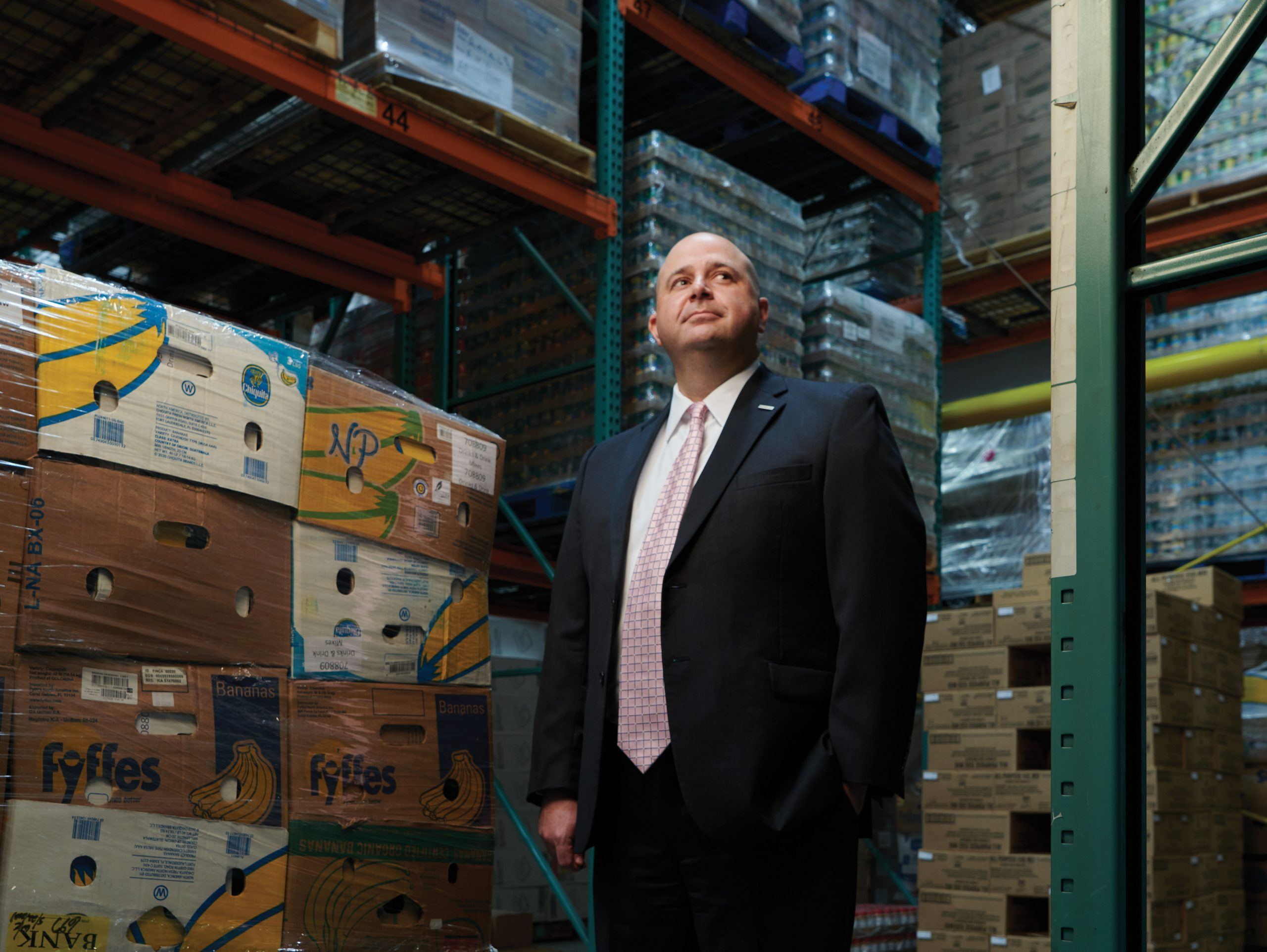 Man standing in food warehouse