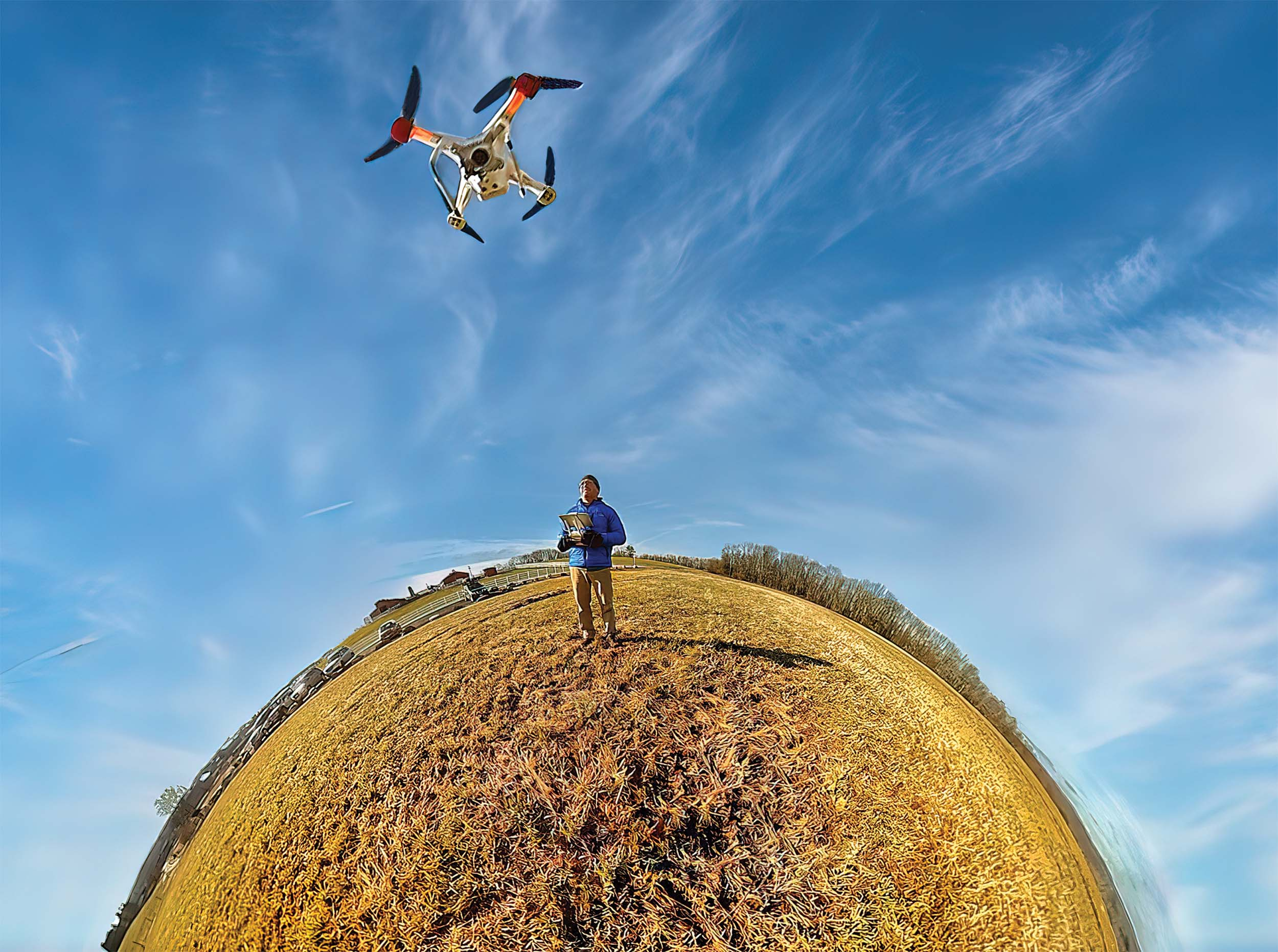 A warped lens view of a man piloting a drone